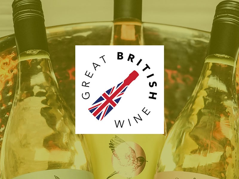 A Great British Wine logo placed over an image of Chet Valley Vineyard wine bottles placed in a metal cooler.